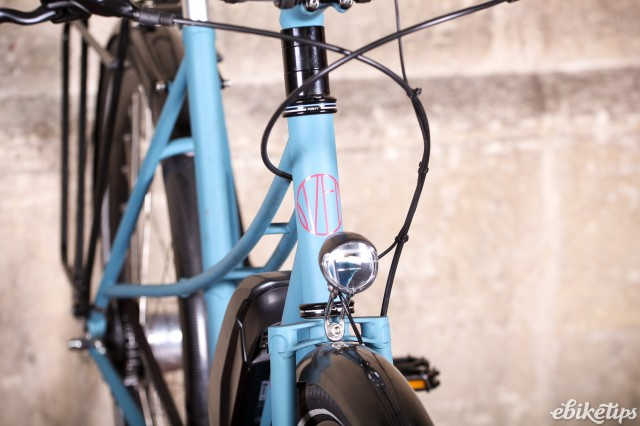 Sven Cycles The Swift Step Through e-bike - head tube badge and front light.jpg