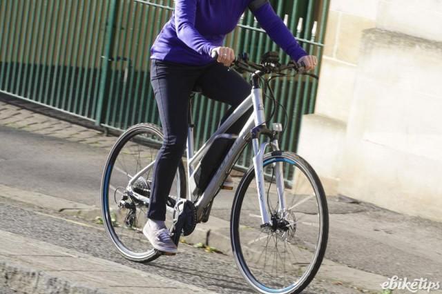 carrera-crossfire-e-womens-electric-bike-riding-4.jpg, action